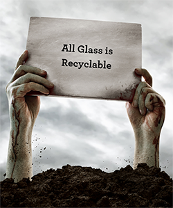 """Zombie hand hold sign saying """"All Glass is Recyclable"""""""